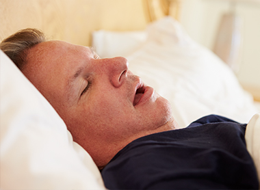 Man Snoring At Night